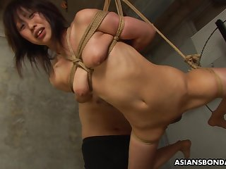 Submissive Asian bimbo Kana Sato gets roped and sucks bushwa